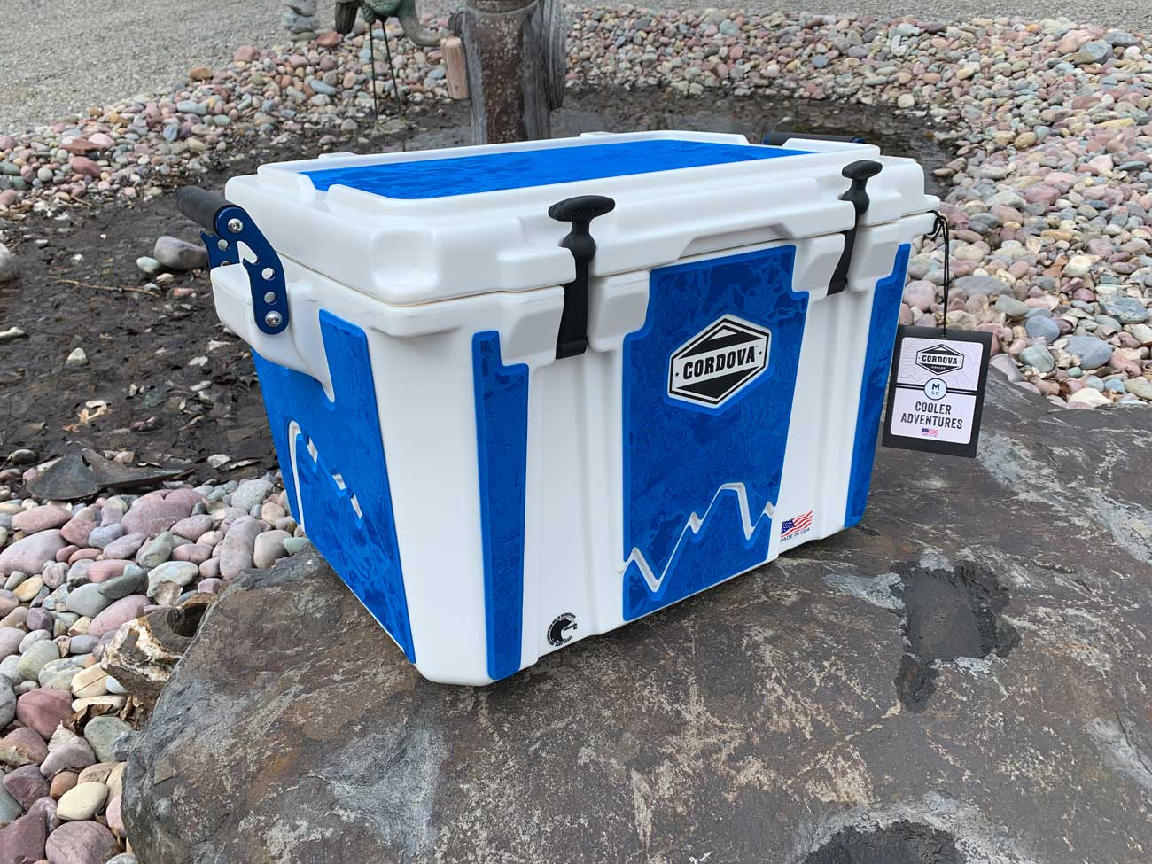 White Cordova cooler with blue custom seadek pads